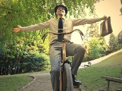Happy Man Riding a Bike