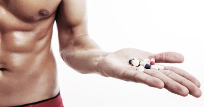 Man Holding Nutritional Supplements