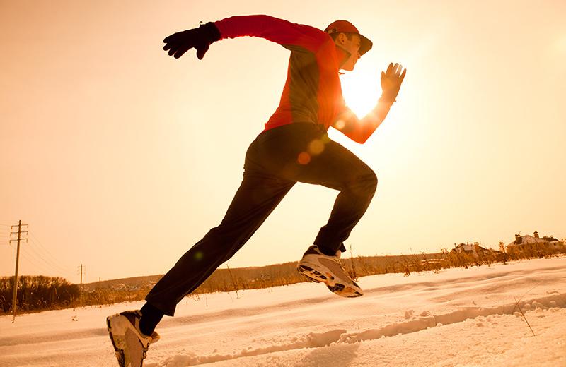 Man jogging in winter snow