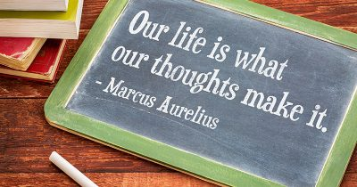 Our life is what are thoughts make it - Marcus Aurelius quote on blackboard