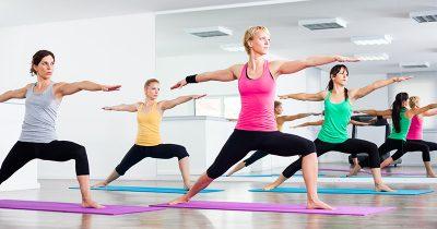 Women Practicing Yoga - Warrior Pose