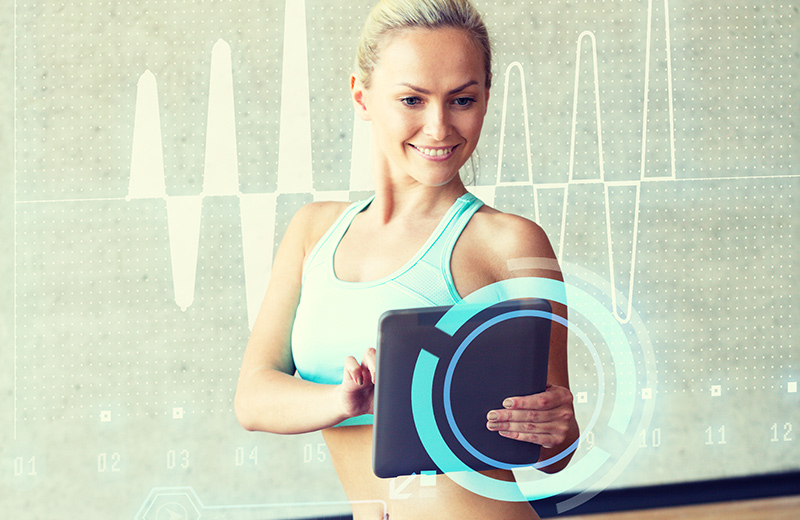 Personal Trainer working on tablet computer