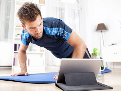 Man at Home Exercising to Fitness Video