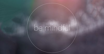 The words 'be mindful' in a circle