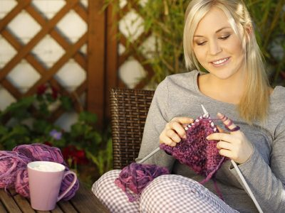 Happy woman knitting
