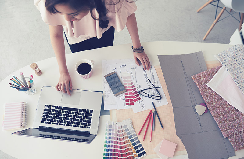 Craftswoman Working on Designs and Selling Crafts Online with Her Laptop