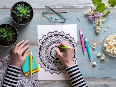 Woman colouring an adult colouring book