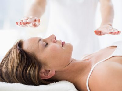 Why Learn Reiki? Woman receiving reiki healing