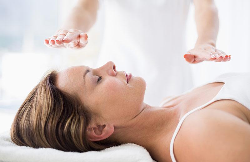 Why Learn Reiki? Woman receiving reiki healing