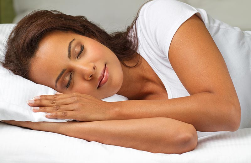 Woman using natural ways to sleep better