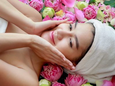 Woman giving herself a facial massage