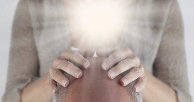 Man receiving Reiki Attunement from Master Reiki Practitioner