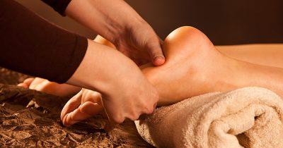 Client receiving reflexology massage