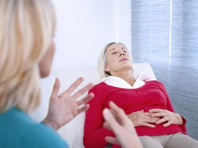Woman undergoing hypnotherapy