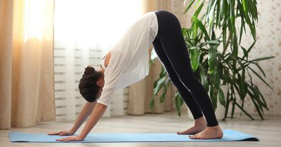 Woman using yoga for back pain