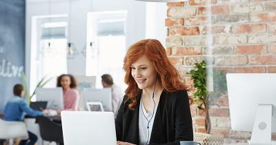 Young woman practicing mindfulness in the workplace