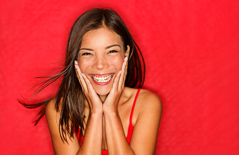 Happy Woman Smiling and Laughing at Laughter Therapy Session