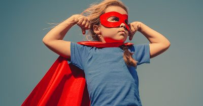 Confident child dressed as a superhero