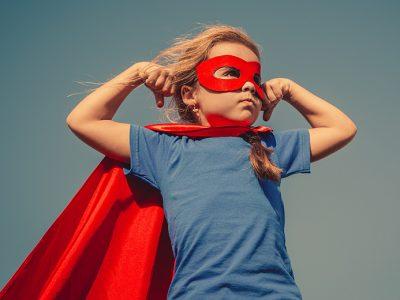 Confident child dressed as a superhero