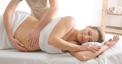 Woman receiving pregnancy massage