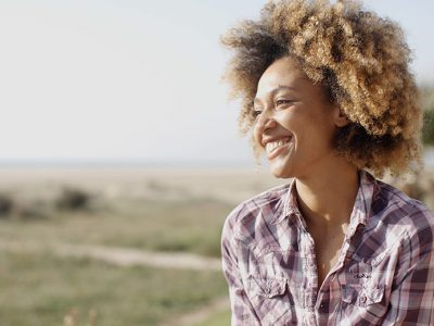 Woman feeling content after learning how to be happy