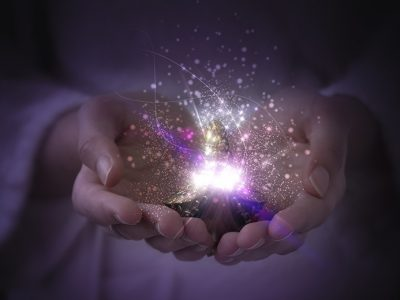 Hands cupped, receiving dreams manifested the law of attraction