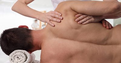Man receiving sports massage from a massage therapist