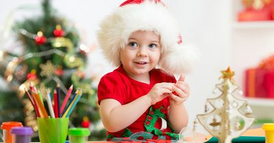 Child engaging in Christmas craft ideas