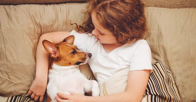 Girl Understands the Reasons to Get a Dog as She Snuggles Up to Her Dog