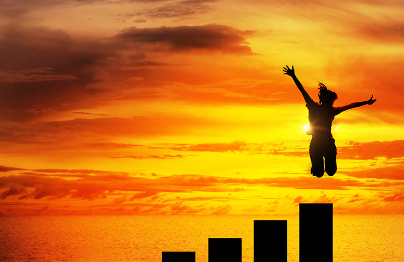 Personal Development Plan Concept - Silhouette of woman jumping from the highest of six progressively larger pillars
