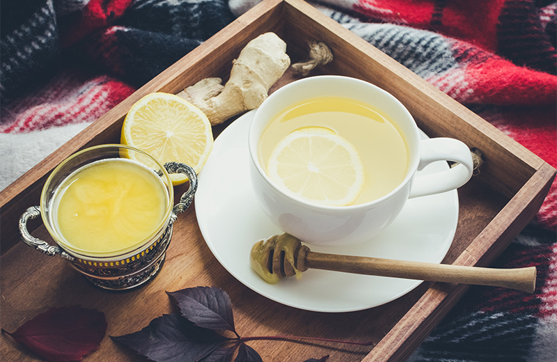 Herbalist remedy tea consisting of ginger, lemon and honey