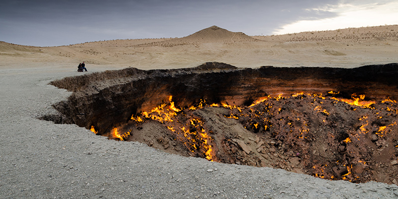 Couple looking at the Darwaza gas crater, Turkmenistan