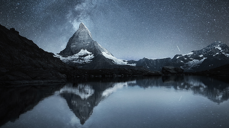 Matterhorn and reflection on the water surface at the night time