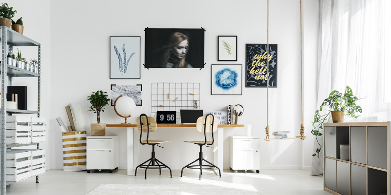 A luxurious white home office with added extras including a swing.