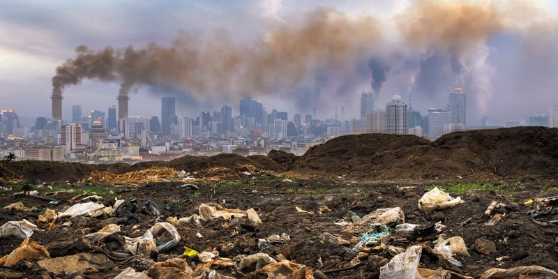 Toxic waste and smog on a city skyline illustrating the climate changing