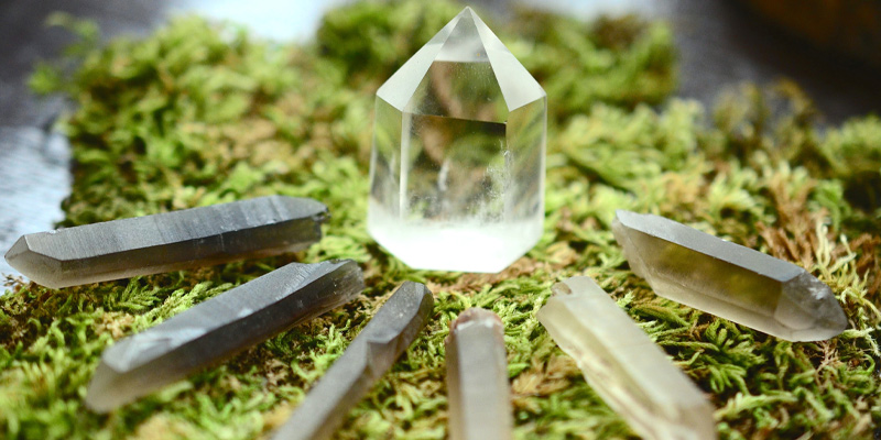 Some healing gems used for a witch alter, including clear quartz crystal tower, and smokey and clear quartz points.