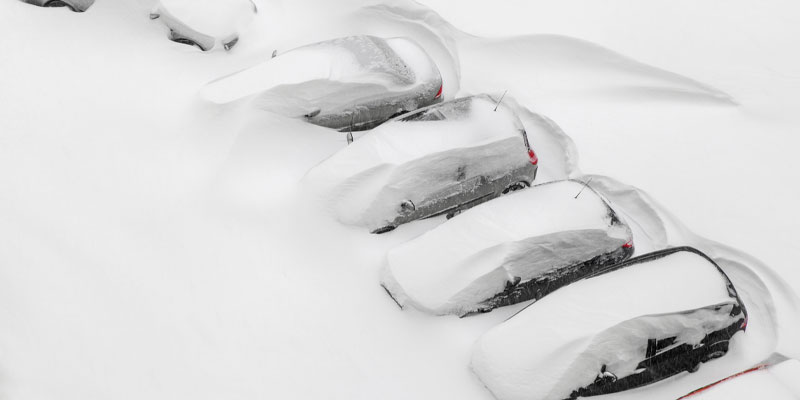 Extreme weather pictured as cars are covered in snow after a blizzard.