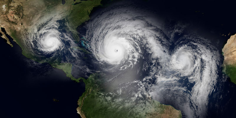 Extremely detailed and realistic high resolution 3d illustration of 3 hurricanes approaching the Caribbean Islands and Florida, shot from space displaying extreme weather. Elements of this image are furnished by Nasa.
