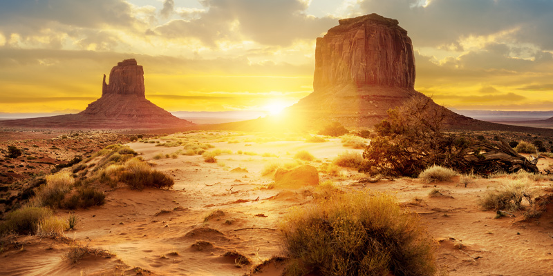 Sunset at the sisters in Monument Valley, USA, an example of one of the prairie biomes.