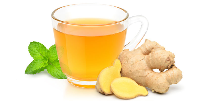 A picture of ginger used to make ginger tea in clear glass cup.