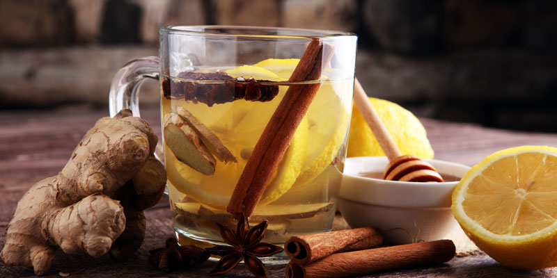 A winter concoction to make ginger tea in a glass cup.