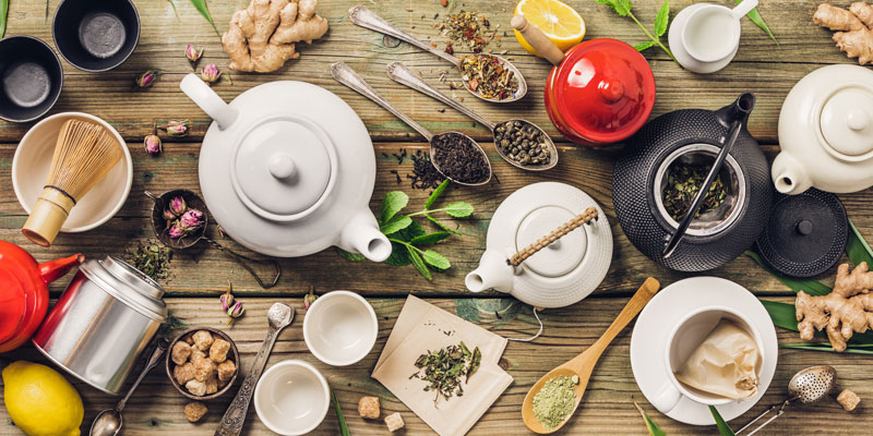 A selection of herbs and teapots in which you can make ginger tea.