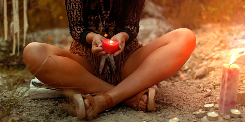 Mystical Woman with red Candles Her Hands in offering to Lilith.