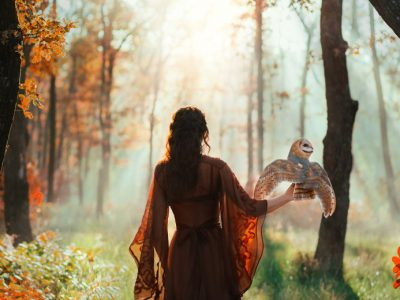 A woman in the woods with an owl, one of the correspondences of Lilith.