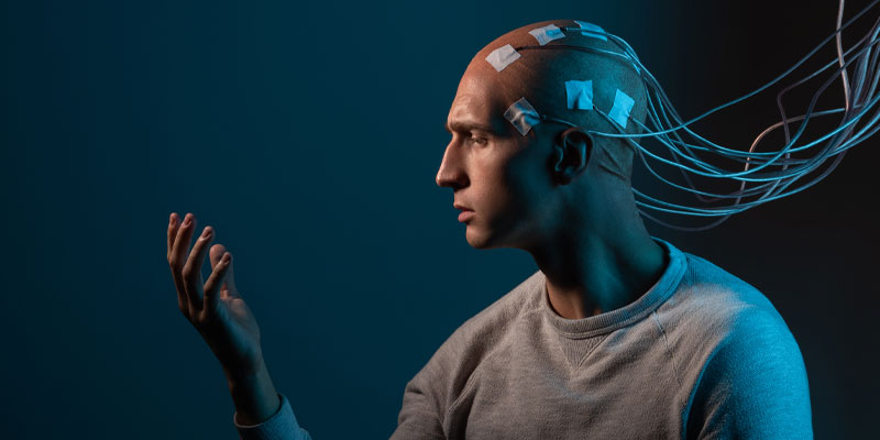 A man testing the memorisation power of his mind wired up to a machine.