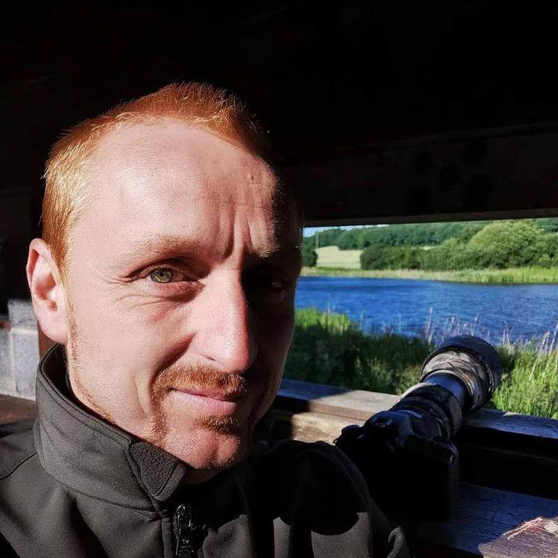 Scott Duffield taking an outdoor photo.