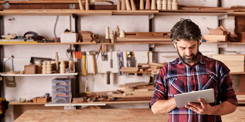 A man in a workshop learning how to start a business.