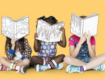 Three children reading unfinished books by authors writing children's books.